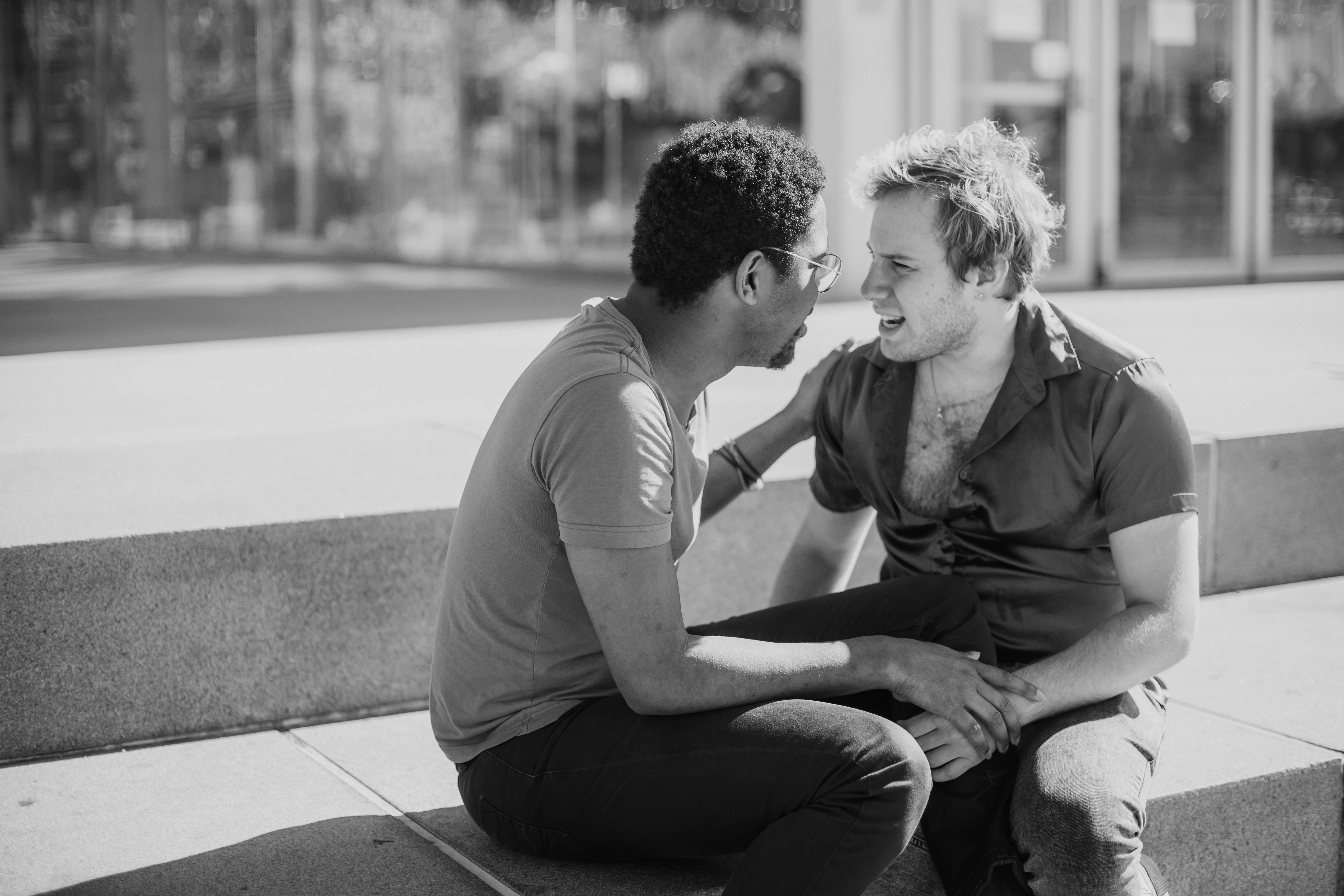 grayscale-photo-of-two-men-talking-4657904